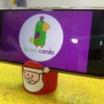 Portacelular navideño con rollo de papel